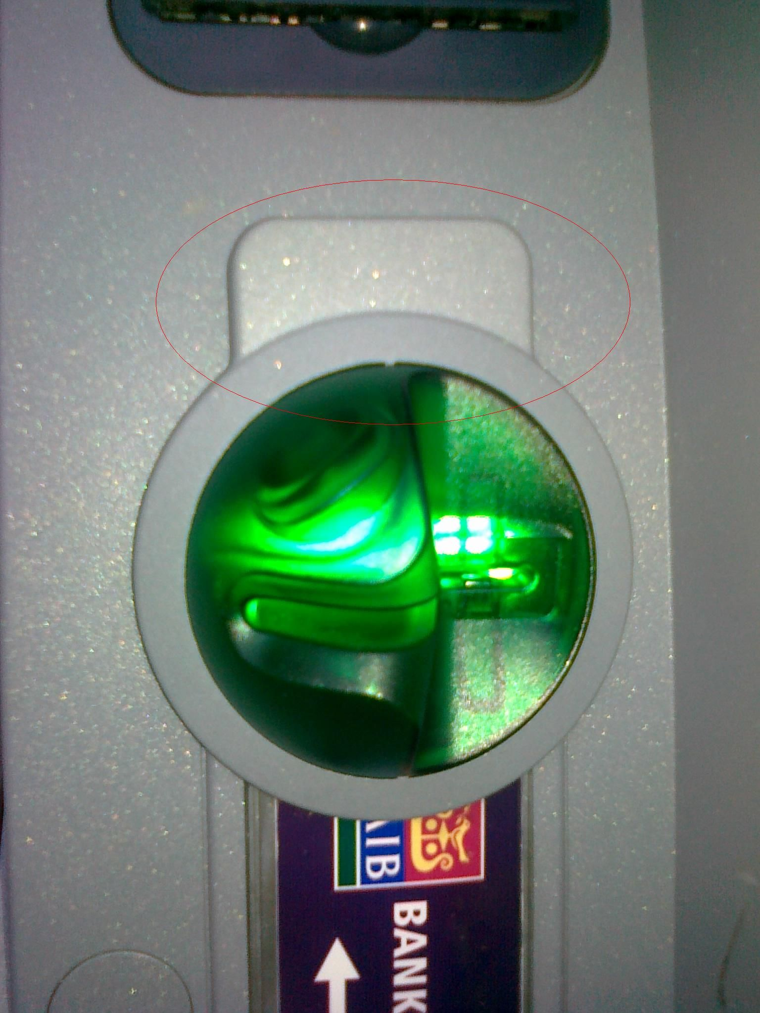 Attached AIB ATM skimming device