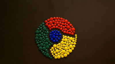 Chrome logo constructed using magnets