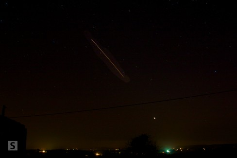 The International Space Station appears as a trail of light blazing across an Irish sky