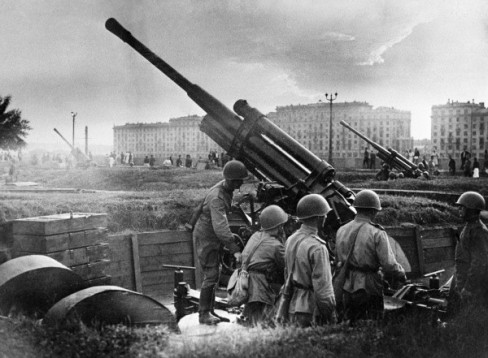 Defenders of Moscow during the WWII years getting in the Gorky Park AAA guns ready for repelling a mock German air attack