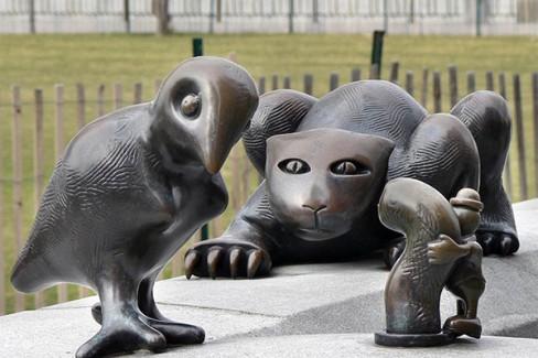 Tom Otterness sculpture: Cat stalks bird stalking worm