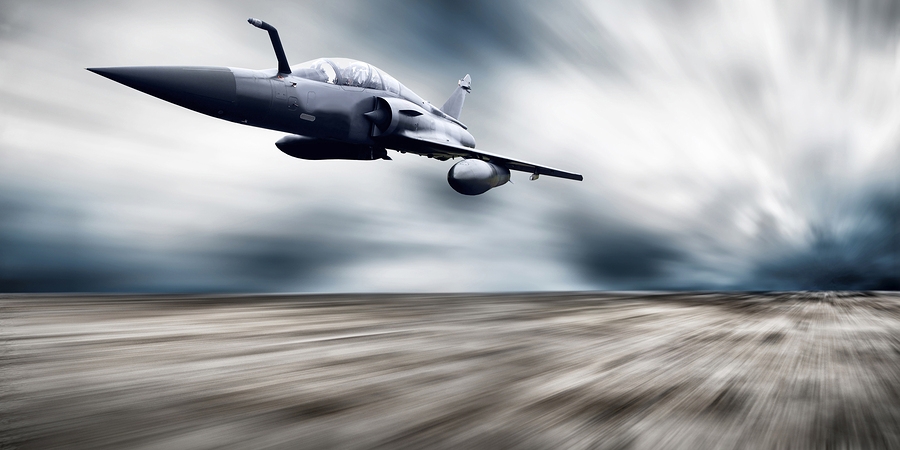 Military airplane flying at speed, via Bigstock.com