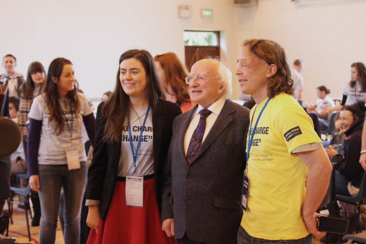 President Higgins taking photographs with some of the participants