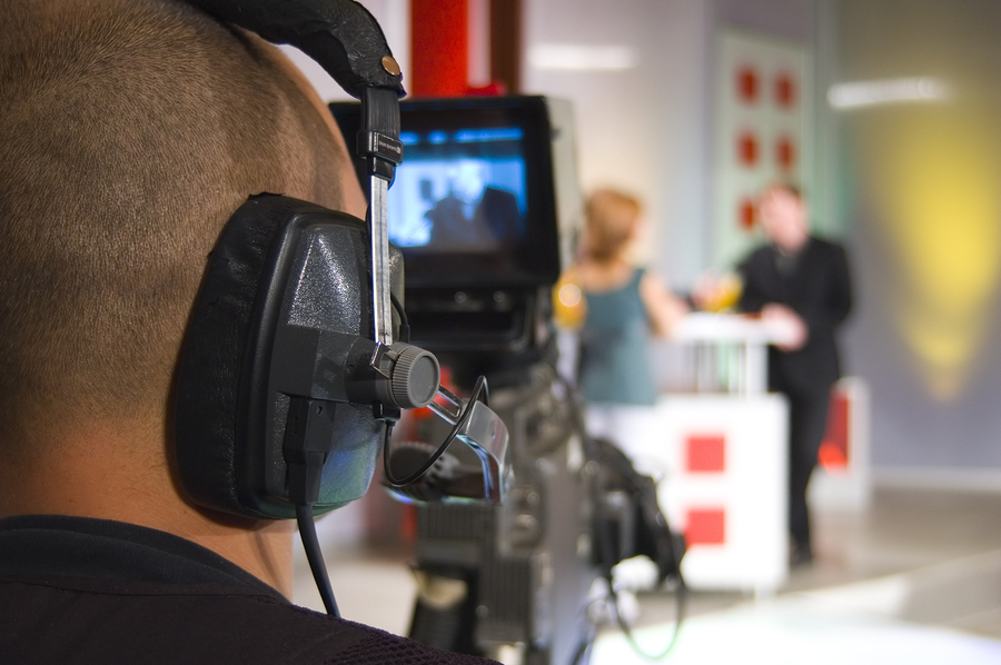BigStock - Cameraman works in the studio