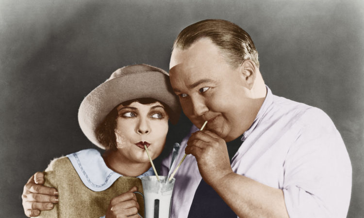 Couple sharing beverage with straw