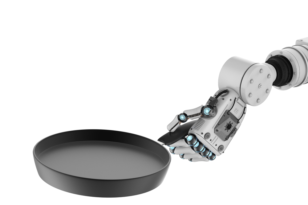 robot hand holding frying pan