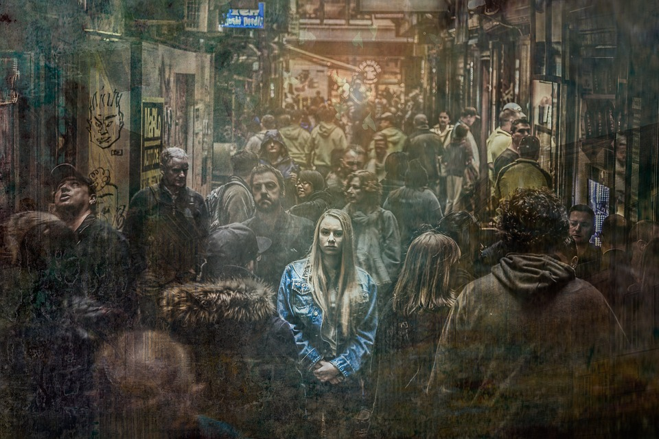 woman alone in crowd