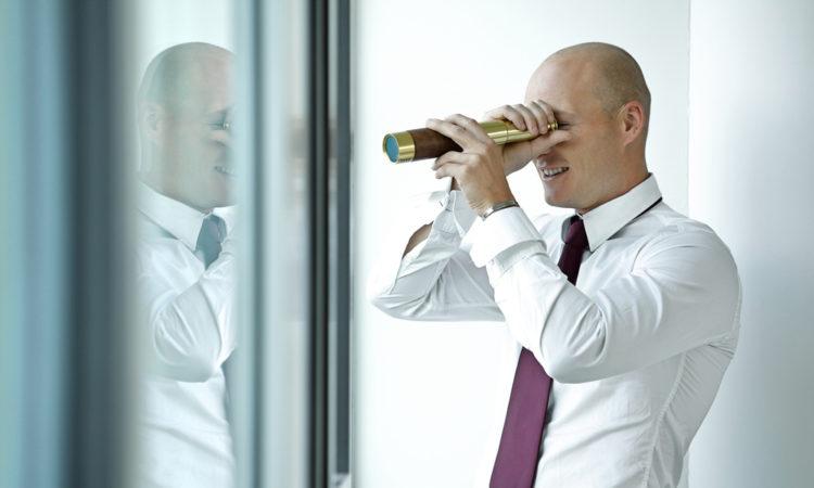 businessman spy glass