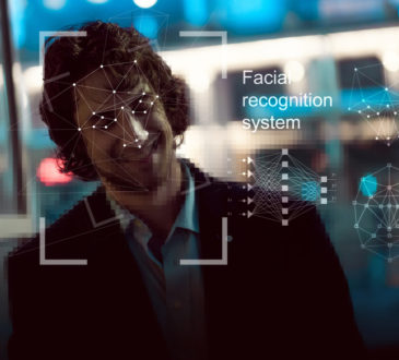 Facial recognition system, concept. Young man on the street face recognition