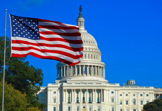 US flag and Capitol Building