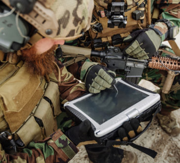 Army personnel working on technology