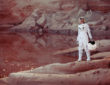 futuristic astronaut on another planet, sandy red planet